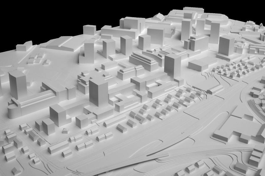 Das Team um Marcel Meili, Markus Peter Architekten hat eine stimmige Komposition aus horizontalen und vertikalen Baukörpern entworfen. (Modellfoto: Amt für Städtebau, Stadt Zürich)
